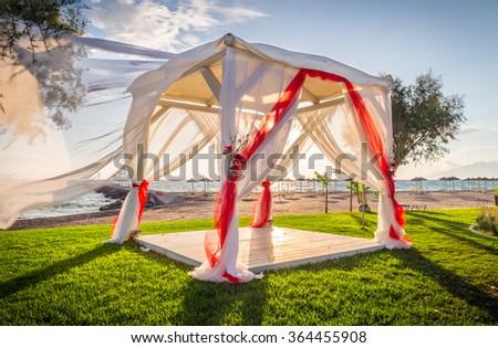 Wedding altar on greek shore at sunrise - stock photo