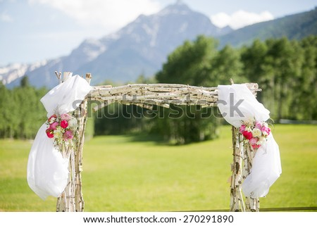 Wedding alter with Roses, Peonies, Ranunculus, and Sweet Pea flowers - stock photo