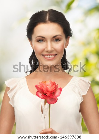 wedding and beauty concept - young woman with flower - stock photo