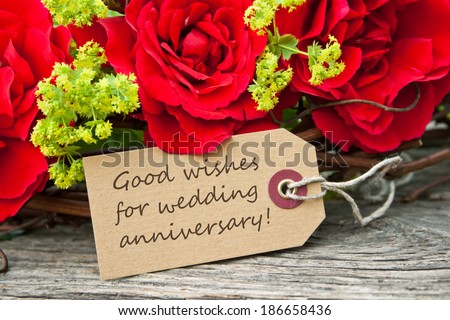 Wedding anniversary card red rosesgood wishes stock photo royalty