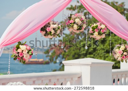 Wedding arch decorated of blossom flowers - stock photo