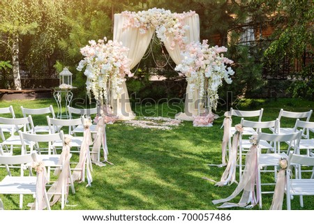 wedding arch decorated cloth flowers outdoors stock photo royalty free 700057486 shutterstock. Black Bedroom Furniture Sets. Home Design Ideas