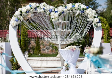 Wedding arch decorated with flowers - stock photo