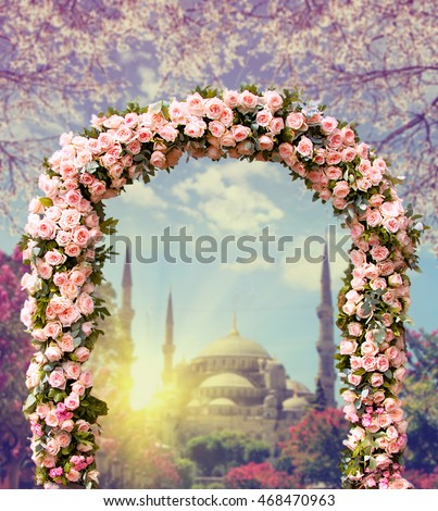 Wedding Arch Decorated With Flowers Of Roses Blue Mosque At Sunset On The Background