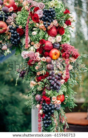Wedding arch decorated fruits flowers apples stock photo royalty wedding arch decorated with fruits flowers apples and grapes junglespirit Image collections