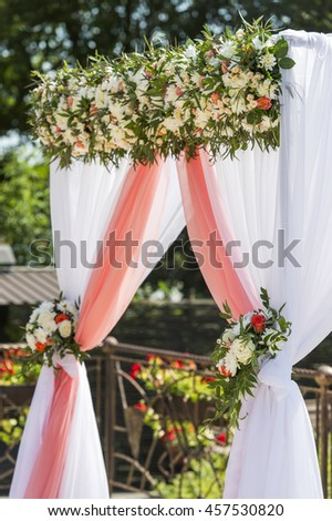 wedding arch for the ceremony flowered roses and chrysanthemums