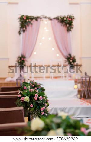 Wedding arch pink tones church decorated stock photo image wedding arch in pink tones in the church decorated with pink and white roses junglespirit Image collections