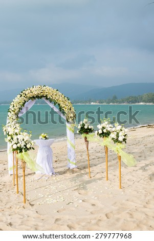 Wedding Arch on Tropical Beach - stock photo