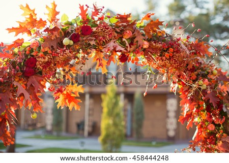 wedding arch with autumn decor - stock photo
