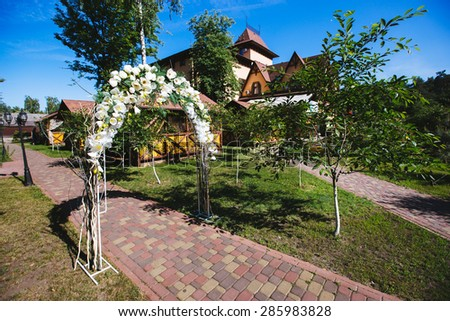wedding arches in nature. Trees around the house - stock photo