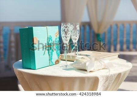Wedding arches in the Tiffany color on the beach. Island. The ocean. Ceremony. Table. Registration. The champagne glasses. - stock photo
