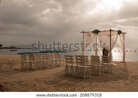 Wedding arches on the beach - stock photo