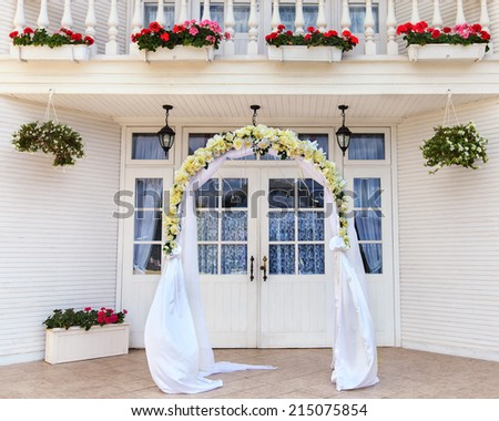 Wedding archway with flowers arranged for a wedding ceremony - stock photo