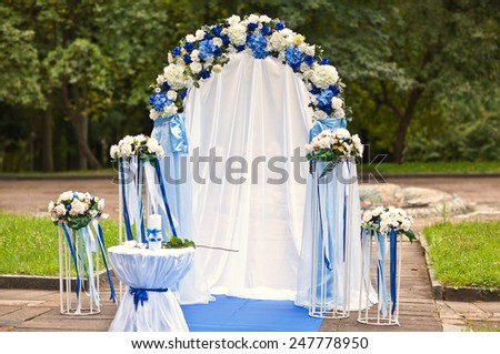 Wedding archway with flowers arranged in park for a wedding ceremony - stock photo