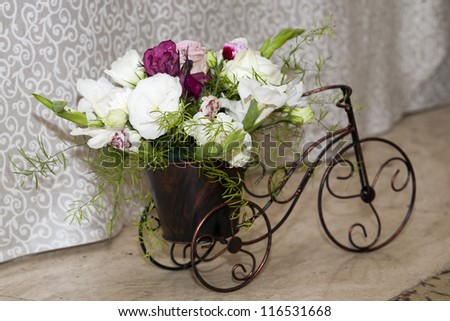 wedding arrangement. bouquet of flower on a bike - stock photo