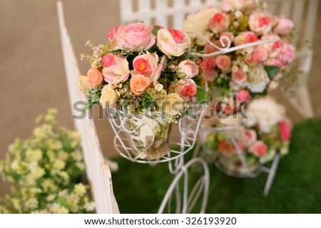 wedding arrangement. fake flower bouquet on bike - stock photo