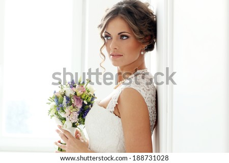 Wedding. Attractive bride with bouquet - stock photo