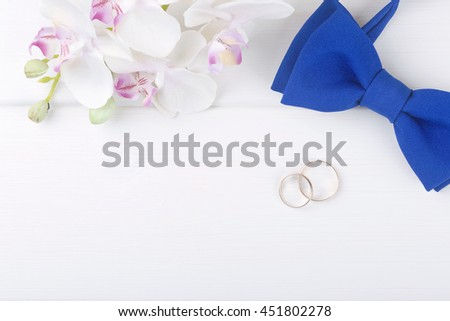 wedding background with golden rings on white wooden table - stock photo