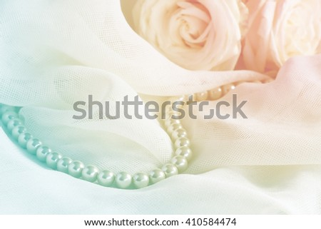 Wedding background with pearl beads and roses  - stock photo