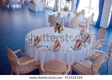 Wedding banquet, small restaurant in a Maritime style, round tables