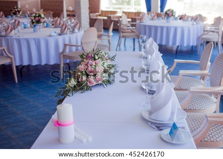 Wedding banquet, small restaurant in a Maritime style, round tables - stock photo