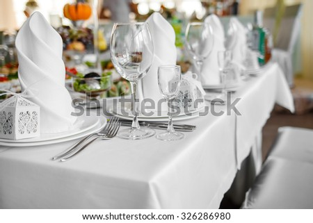 Wedding banquet  table with dishware and meal,  waiting for bride and groom.