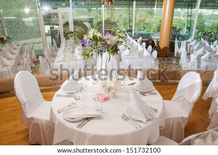 wedding banquet table with flower decoration - stock photo