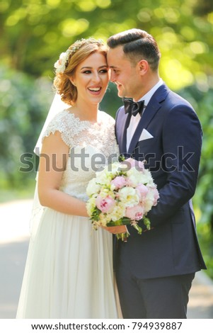 Wedding: beautiful bride and groom in the park on a sunny day