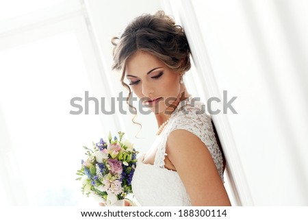 Wedding. Beautiful bride with bouquet - stock photo