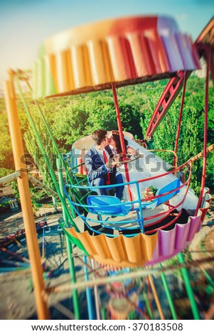 Wedding, beautiful couple smiling in a carousel of sunny day