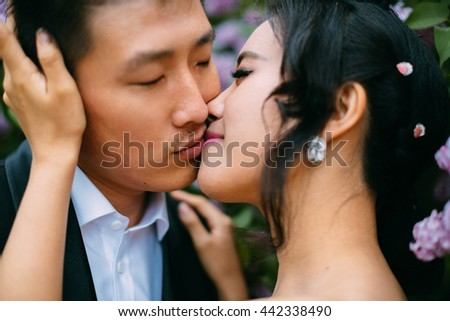 Wedding, Beautiful Romantic Bride and Groom Kissing and Embracing - stock photo