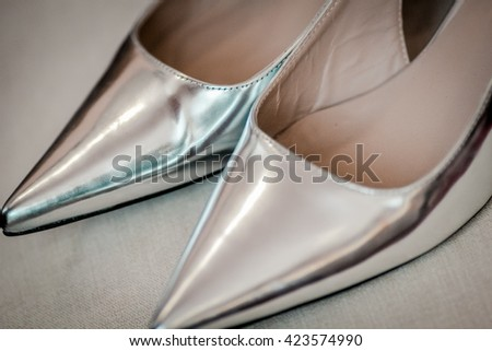 wedding, beautiful, silver shoes with high heels - stock photo