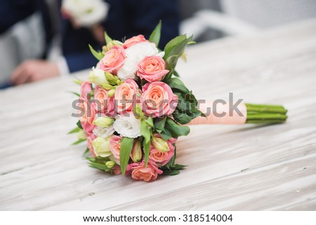 wedding blossom bouquet at white wood table