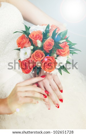 Wedding bouquet at bride's hands - stock photo