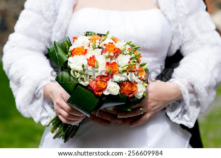 wedding bouquet at bride's hands  - stock photo