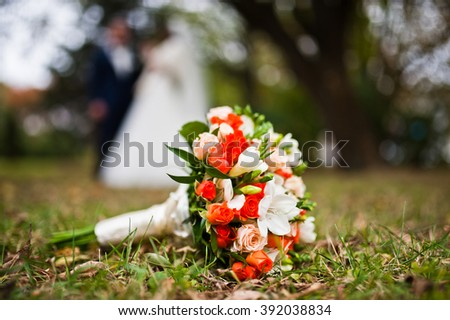 Wedding bouquet at grass background wedding couple - stock photo