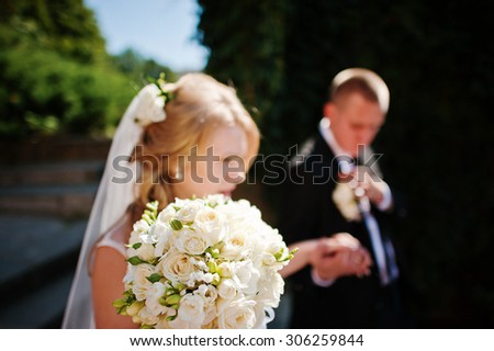 wedding bouquet at hand of bride