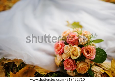 wedding bouquet background wedding dress in yellow autumn leaves - stock photo