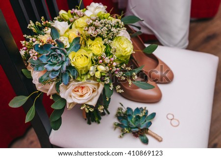 Wedding bouquet, boutonniere and shoes in the room