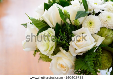 Wedding bouquet from chrysanthemum, gerbera, roses, bells, lily, daisy lying on table