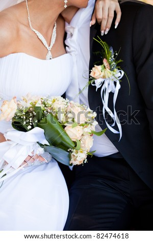 Wedding bouquet from peach-coloured roses and buds - stock photo