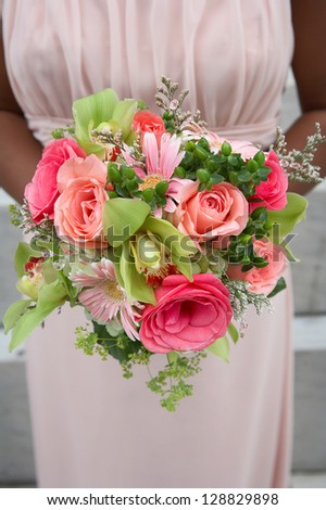 Wedding bouquet held by African-American bridesmaid - stock photo