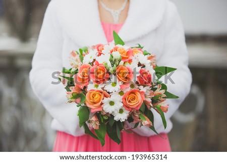 wedding bouquet in the bride's hands - stock photo