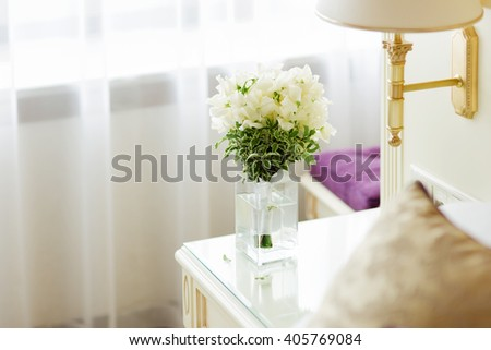 Wedding bouquet in vase. Bride's traditional symbolic accessory. Floral composition with white flowers. - stock photo