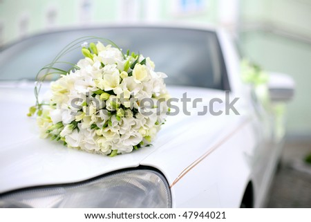 Wedding bouquet lies on the car. Wedding day. Summer Day