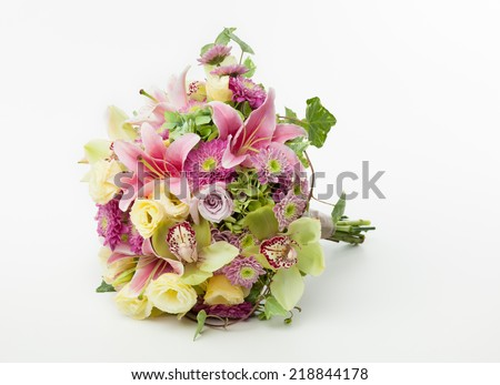 Wedding Bouquet Lying Down On White Background Cymbidium Orchids Roses Chrysanthemum Lily