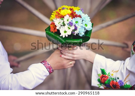 Wedding bouquet newlyweds with daisies. - stock photo