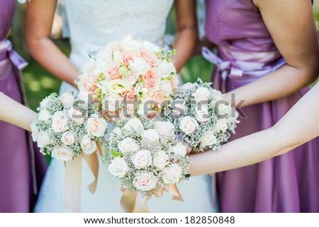 Wedding bouquet of a bride and bridesmaid - stock photo