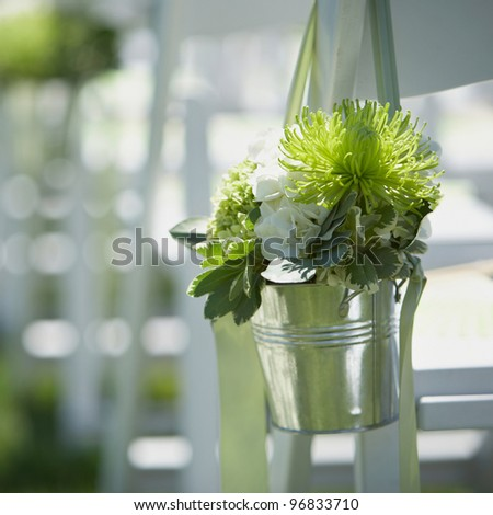 Wedding bouquet of flowers at outside ceremony - stock photo