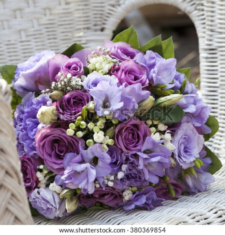 wedding bouquet of fresia on the chair - stock photo